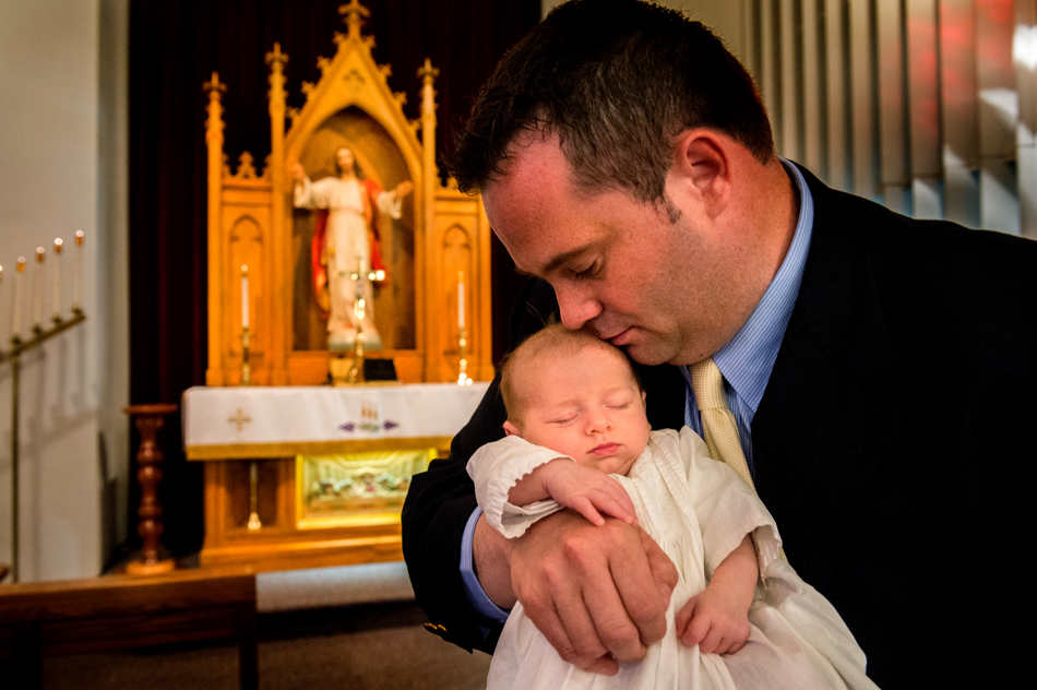 FRED ZWICKY/JOURNAL STAR Father's Day was extra special for William Bosch of Bradford as he and his six-week-old son Conrad were both baptized Sunday, June 15 at St. Paul's Lutheran Church in Brimfield. Making the day even momentous is that Conrad is the 100th member of the family to wear an antique baptism gown that dates back to 1882. William was the 41st family member to wear the gown. Conrad's grandfather and namesake, was the 16th. The first family member to wear the gown was Maggie Schneider on her christening at St. Joseph's Church in Peoria on Dec. 10, 1882. The gown is entrusted to one family member as a guardian as it now travels from state to state for baptisms.