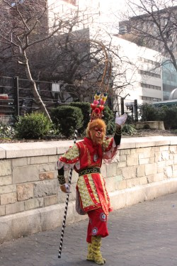 a Monkey King performer on the street of New York City