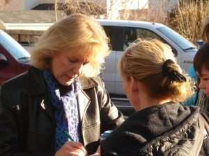 Tami Lohman helps an art student prepare before the 2012 Chinese New Year parade in Jacksonville, Oregon