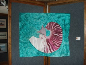"""Nautilus,"" handpainted silk wall hanging by Judy Elliott on display at Art Presence"