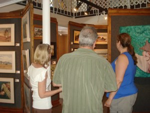 Kathleen Hoevet discusses her photography with visitors to the Art Presence Art Center gallery