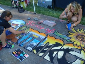 Cathy puts the finishiing touches on the wine glasses and Laila paints the outlines for definition