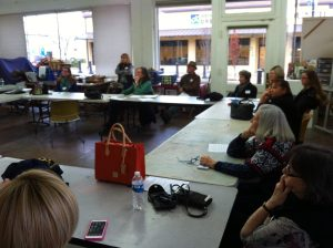 Participants in a Community Meeting take part in a discussion about the Arts Alliance