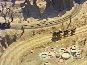 photo of a stage coach passing the tracks of the mine train in old Disneyland