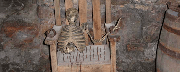 skeletonchairtorturebanner