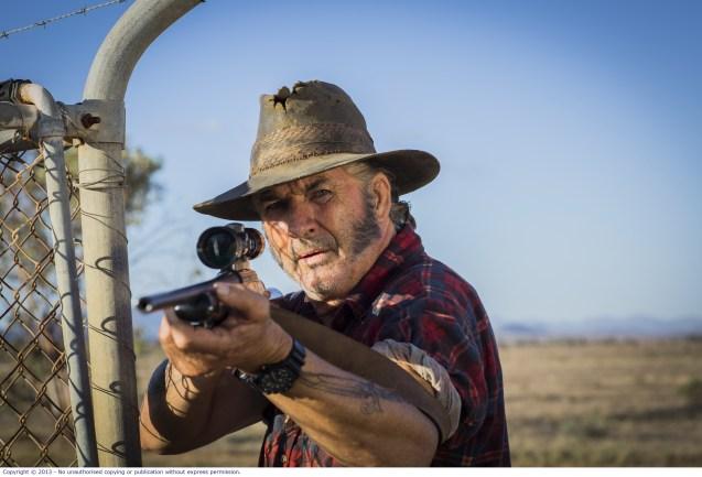 WolfCreek2_John Jarratt as Mick Taylor with gun 8