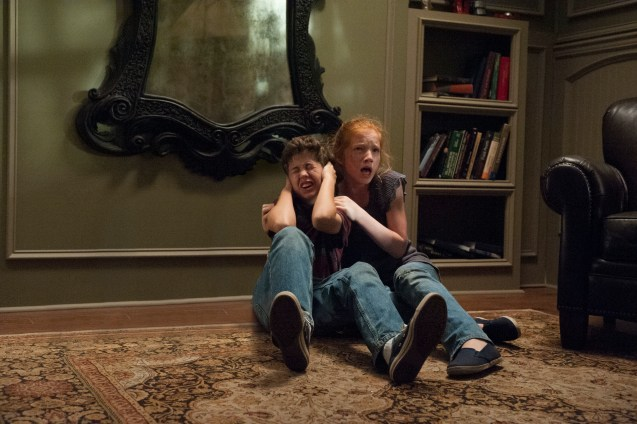 M174 Garrett Ryan (left) and Annalise Basso (right) star in Relativity Media's OCULUS. Photo Credit: John Estes ©2013 Lasser Productions, LLC. All Rights Reserved.