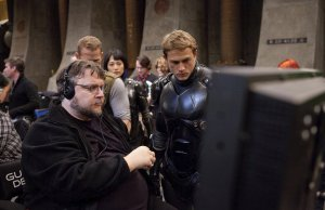 ***SUNDAY CALENDAR STORY FOR JUNE 30, 2013. DO NOT USE PRIOR TO PUBLICATION********** EXCLUSIVE (L-r) Director Guillermo del Toro and CHARLIE HUNNAM on the set of the sci-fi action adventure aíWarner Bros. Pictures and Legendary Pictures movie Pacific Rim,aì a Warner Bros. Pictures release. Photo by Kerry Hayes
