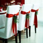 White chairs with evergreen details for Christmas
