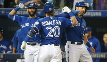 TORONTO, CANADA - APRIL 23: Josh Donaldson #20 of the Toronto Blue Jays is congratulated by Kevin Pillar #11 and Jose Bautista #19 after hitting a three-run home run in the second inning during MLB game action against the Oakland Athletics on April 23, 2016 at Rogers Centre in Toronto, Ontario, Canada. (Photo by Tom Szczerbowski/Getty Images)