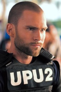 Seann William Scott as Private Roland Taverner / Officer Ronald Taverner.