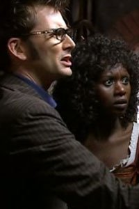 David Tennant as the Doctor, and Velile Tshabalala as Rosita in the Doctor Who Christmas episode