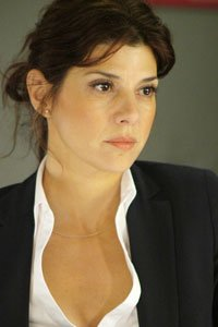 Marisa Tomei as the determined reporter.