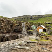 A long boat ramp and boat houses on Suðuroy, Faroe Islands. | shot by Jon Armstrong for Blurbomat.com