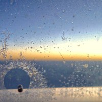 Ice crystals on an airplane window.