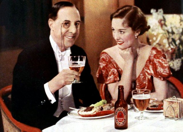 A man and a woman drinking Whitbread Pale Ale, 1930s.