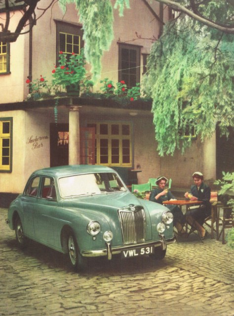 MG Magnette parked outside a pub while two women have orange juice. (And vodka?)