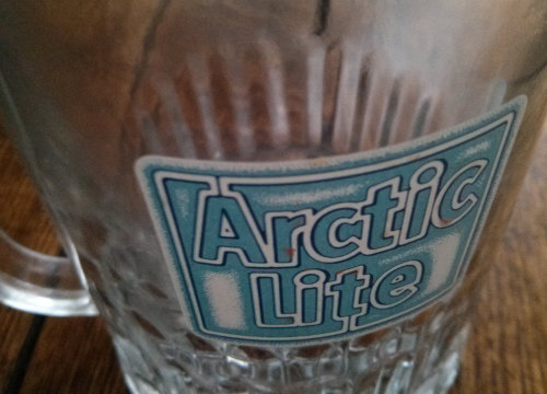 Logo on an Arctic Lite beer glass.