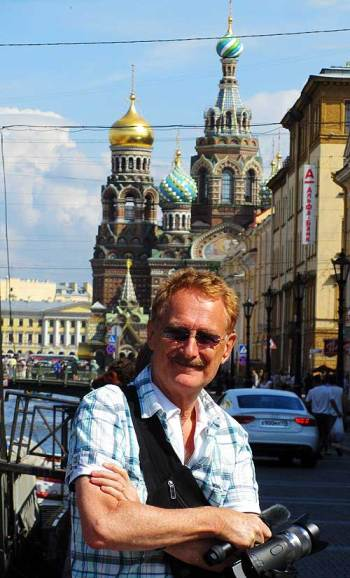 street crime in St. Petersburg, Russia. Bob Arno on the Canal Griboyedova bridge in front of the Metro station. In the background is the spectacular Church on the Spilled Blood.
