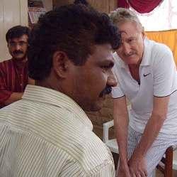 Street crime in Mumbai, India: Bob Arno questions a thief in custody.