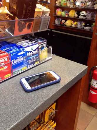 Easy stealing: An employee's personal phone left unattended in a shop.
