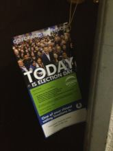 A Vision Vancouver doorhanger placed inside an apartment building on election day.