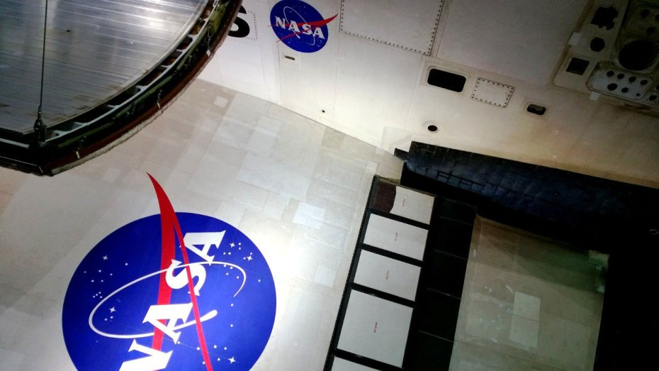 The wing of Atlantis as viewed from the exhibit. The NASA logo, which remains proudly displayed throughout the Kennedy Space Center, is highlighted throughout the exhibit, showing NASA's major achievement through the shuttle era.