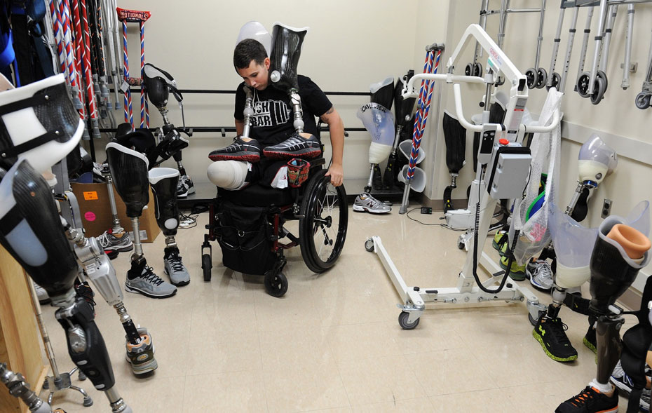 Army Staff Sgt. Sam Shockley, who was injured in Afghanistan when he stepped on a buried bomb, prepares to work on his balance and on walking with prosthetic legs at Walter Reed National Military Medical Center in Bethesda. Matt McClain/The Washington Post