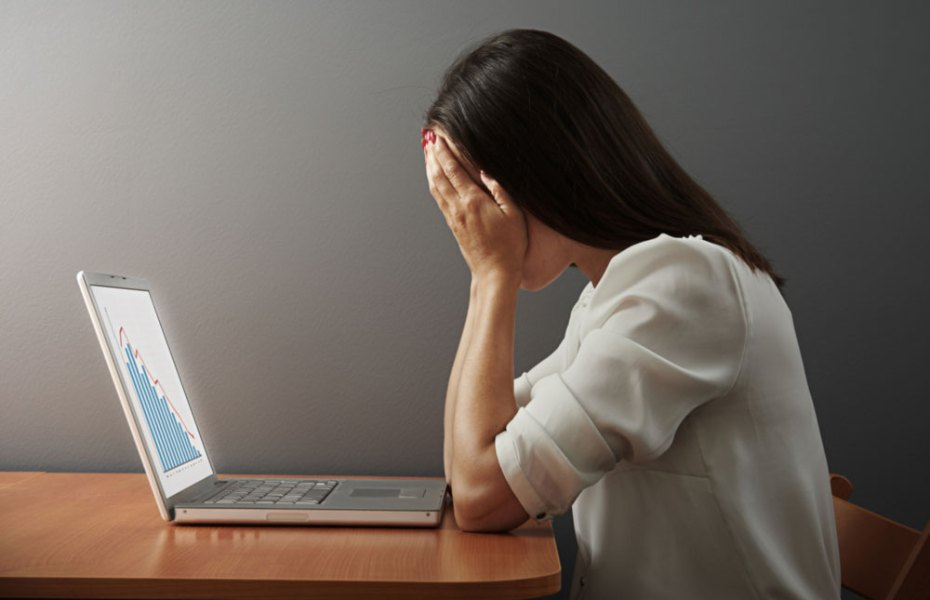 """""""depressed woman covering her face by the hands over dark wall,"""" Shutterstock."""
