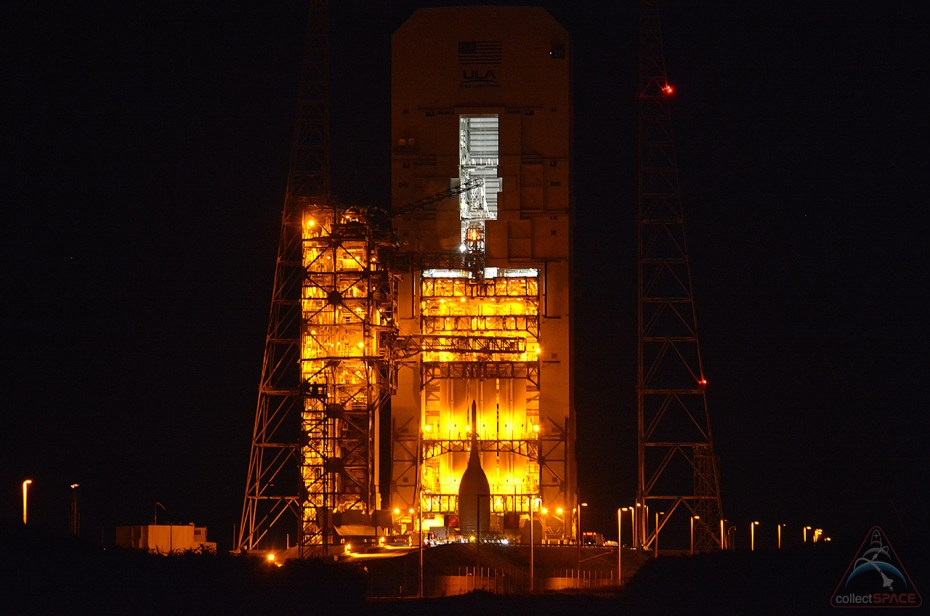 NASA's first space-bound Orion capsule is seen in silhouette, set against the pad lights at Cape Canaveral Air Force Station Space Launch Complex 37B on Wednesday, Nov. 12. (collectSPACE)