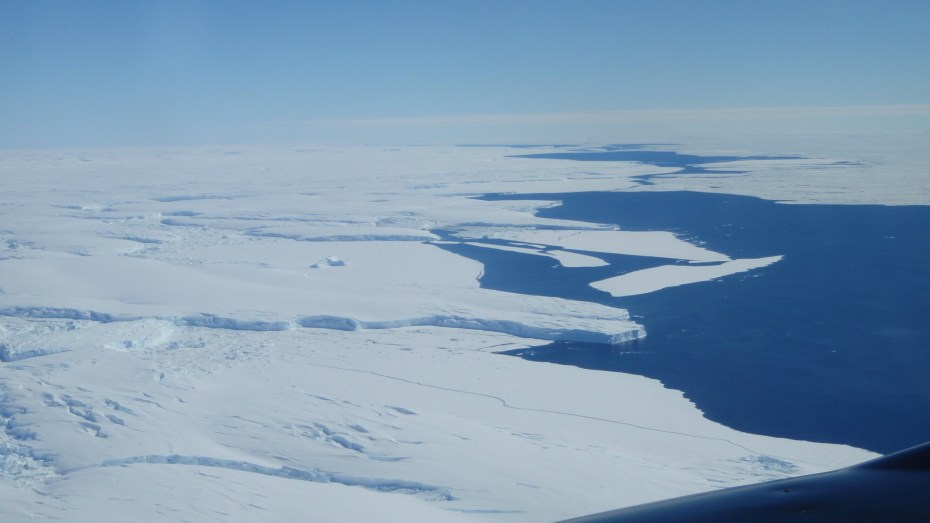 Aerial photo of Totten Glacier's ice shelf edge taken during one of the team's geophysical survey flights. Image: Jamin Greenbaum, U. Texas