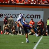 ECU's Worth Gregory punted six times in the first half at Virginia Tech. (Photo by Al Myatt)