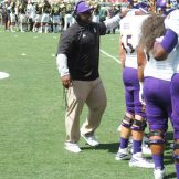 ECU running backs coach Antonio King gives the offensive unit encouragement.