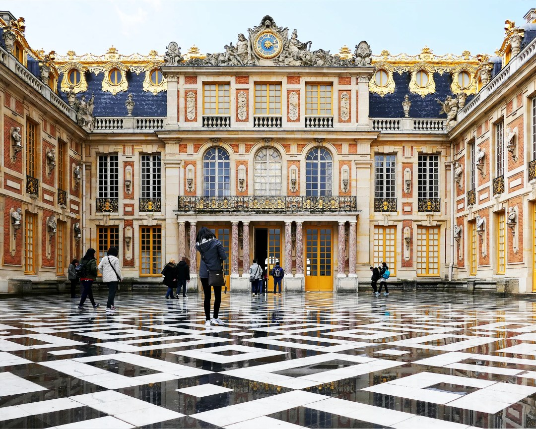 The marble design on the exterior tiles at the Palace of Versailles is inspiration for a front yard makeover