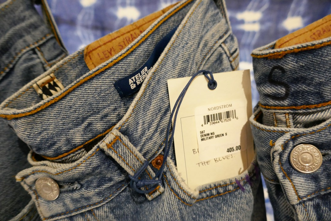 Close-up of Rack of faded jeans at pop-in at Nordstrom