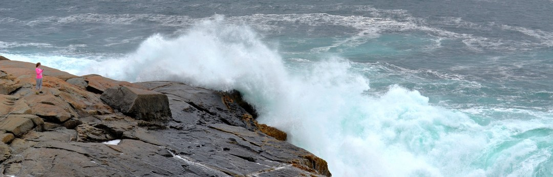 Person who is too close to waves at Peggy's Cove