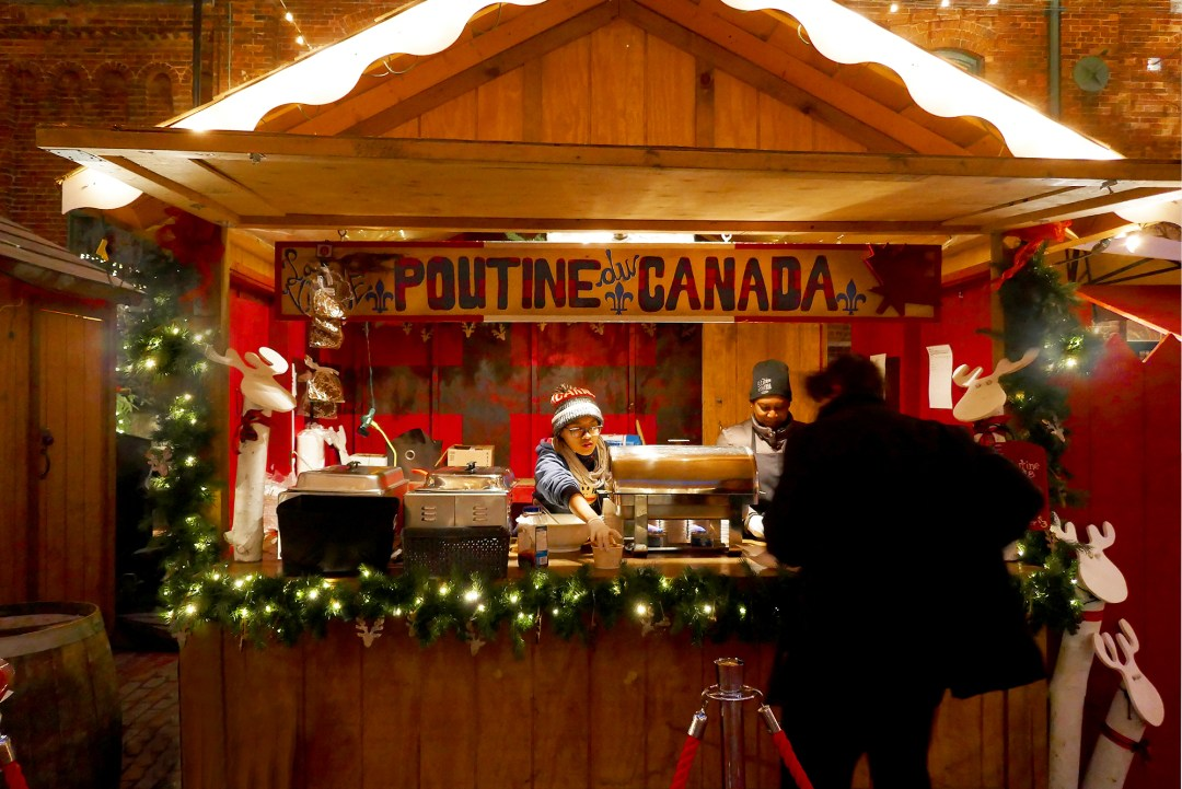 Poutine at the Snow globes at the Christmas tree at the Toronto Christmas Market in the Distillery District