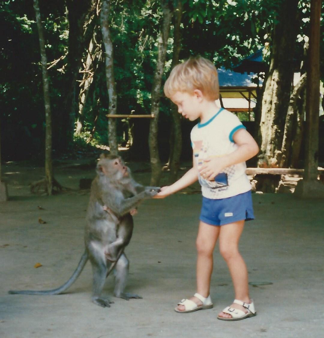 Feeding a monkey in Bali
