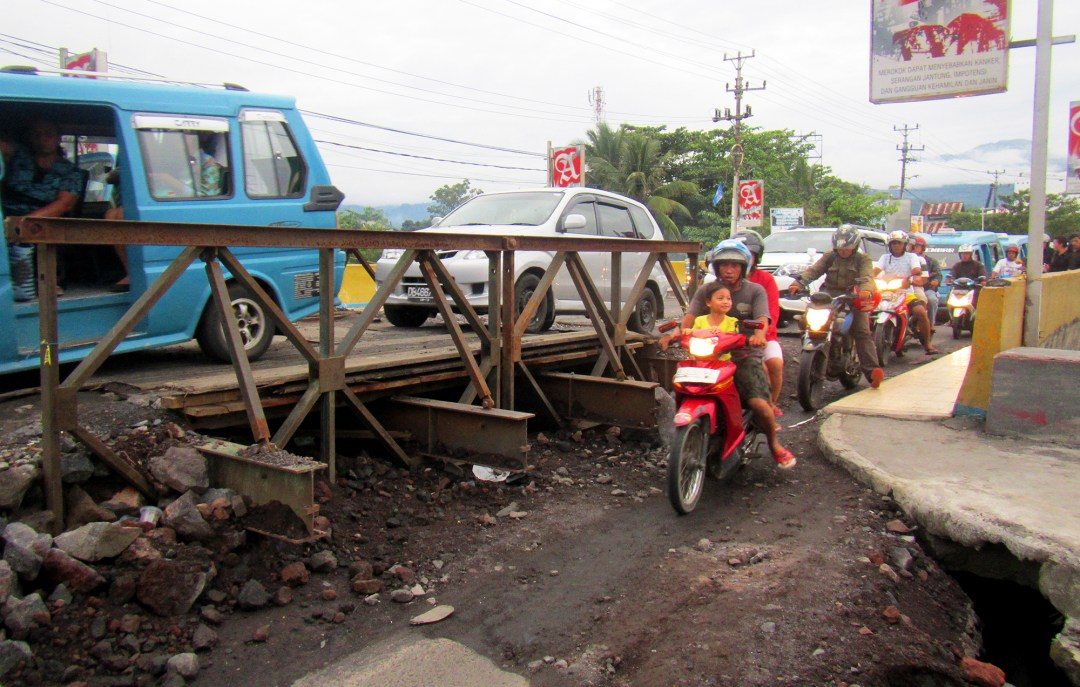 Motorcycles crossing the bridge in Manado in North Sulawesi