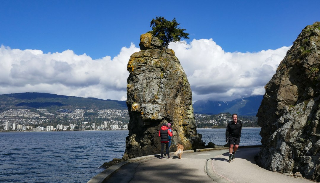 Rollerblader past Siwash Rock in Stanley Park for boomervoice