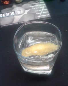 The ice cube fills most of the glass in this vodka old fashioned