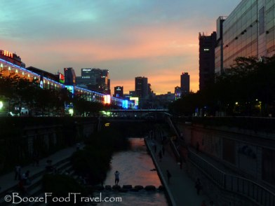 As the sun sets on Cheonggyecheon Stream in Seoul