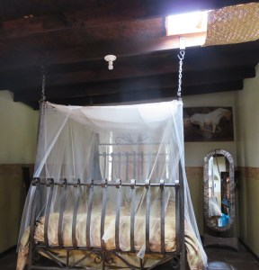 A romantic hanging bed in a guestroom