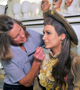 An actor in makeup and costume for the depiction of Annie Oakley