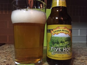 Sierra Nevada Five Hop IPA poured into a nonic pint glass.