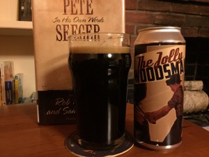 Banded Horn Jolly Woodsman Coffee Stout poured into a nonic pint glass.