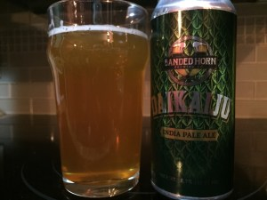 Banded Horn Daikaiju Double IPA poured into a nonic pint glass.