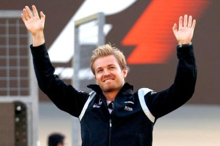 Nico Rosberg edged Lewis Hamilton for pole for Japan's key championship battle on Sunday.