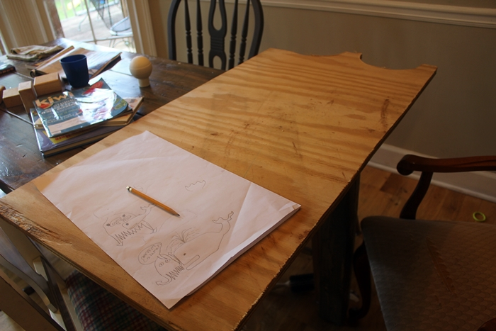 whale sketches and uncut plywood