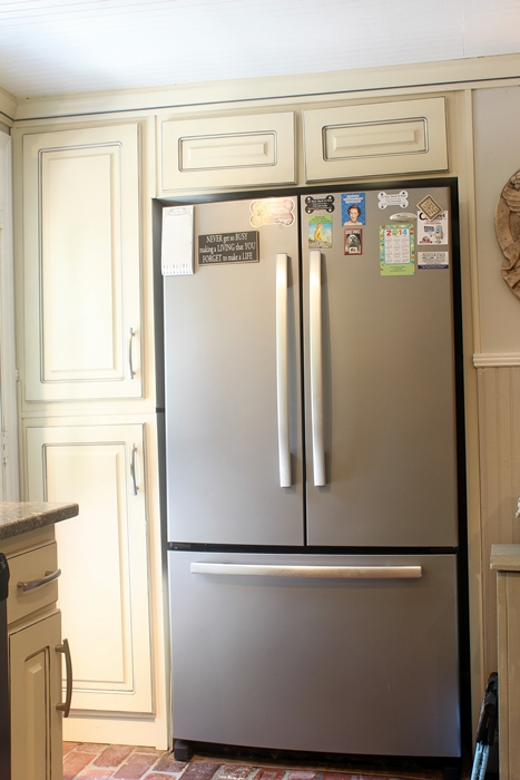 built in refrigerator and cabinets